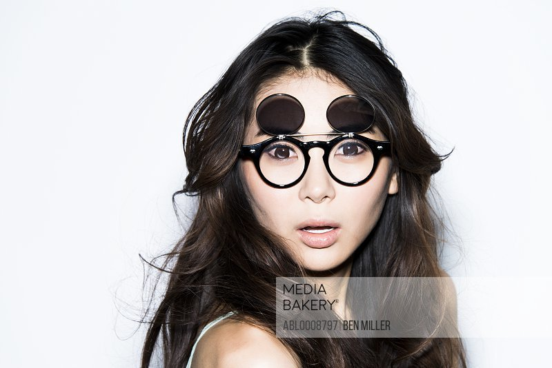 Young Woman Wearing Glasses with Flip Up Shades