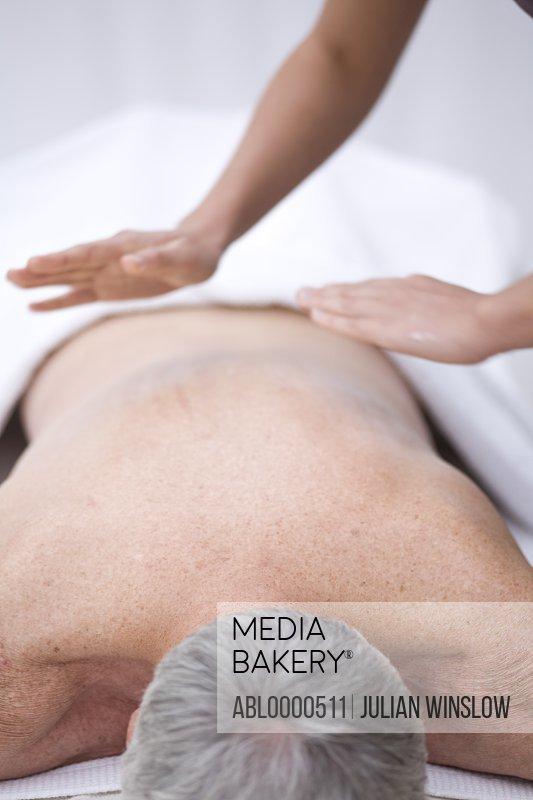 Man receiving a back massage