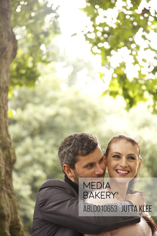 Close up Portrait of Couple Outdoors Smiling