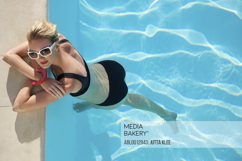 Elevated view of a woman at edge of swimming pool