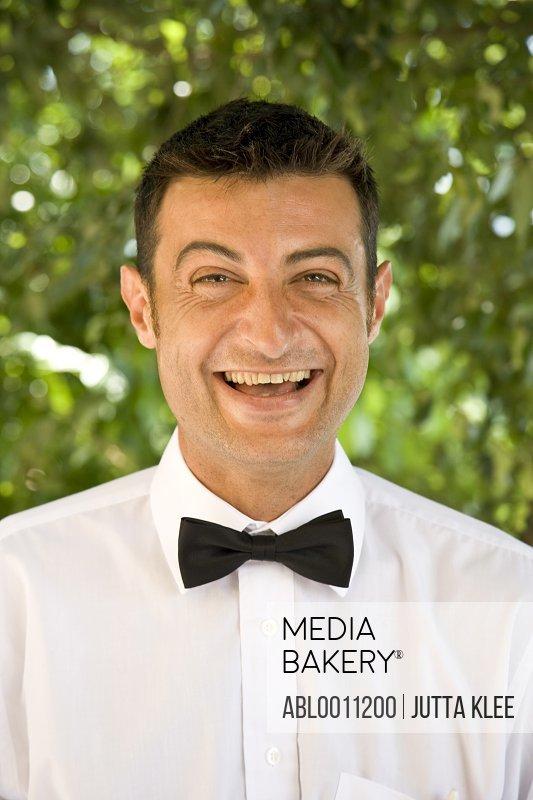 Waiter laughing