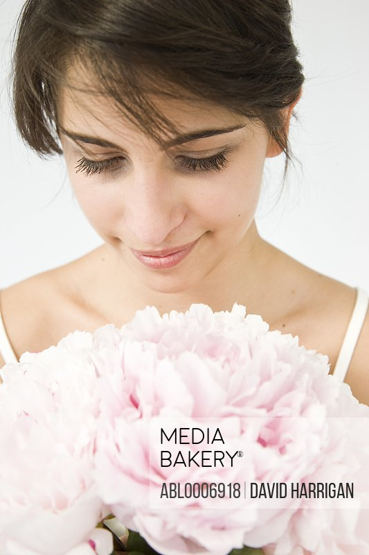 Woman Holding Pink Peonies