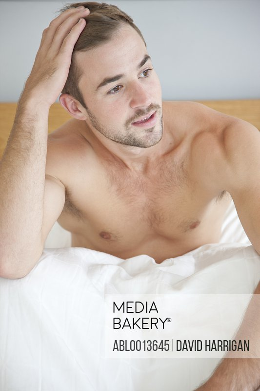 Man Sitting in Bed