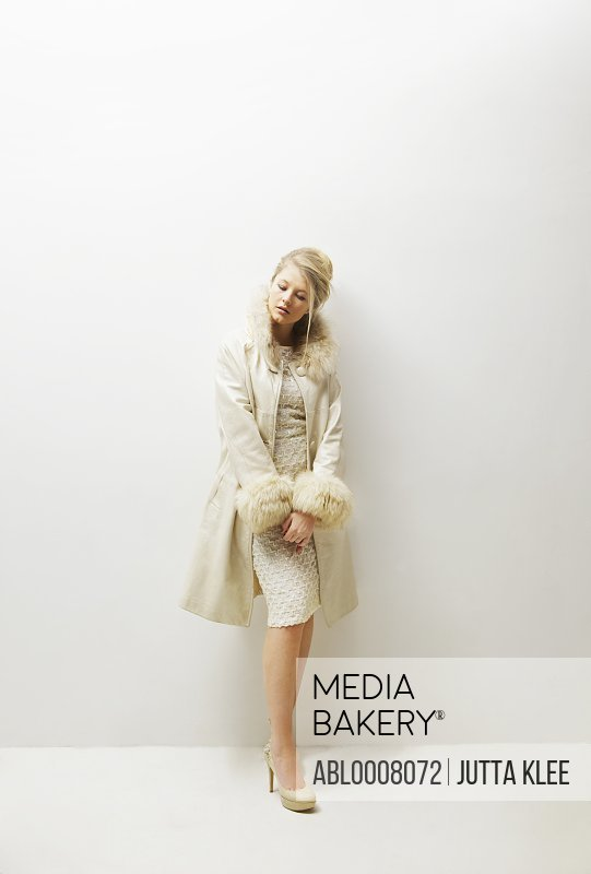 Woman in Fur Trim Coat