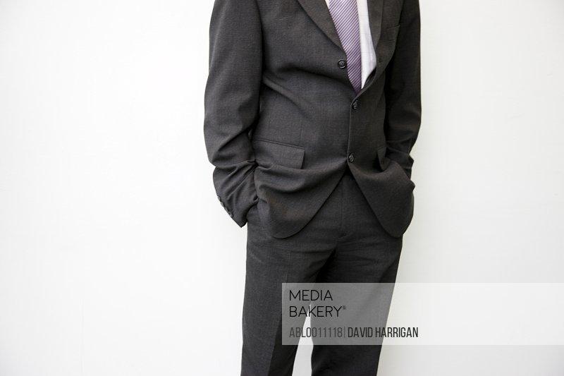 Portrait of headless businessman with hands inside pocket
