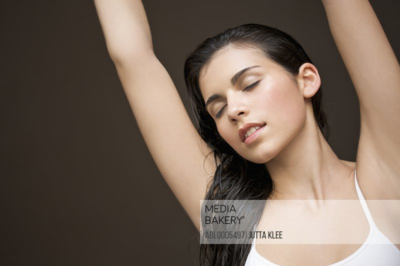 Woman with her arms stretched above her head