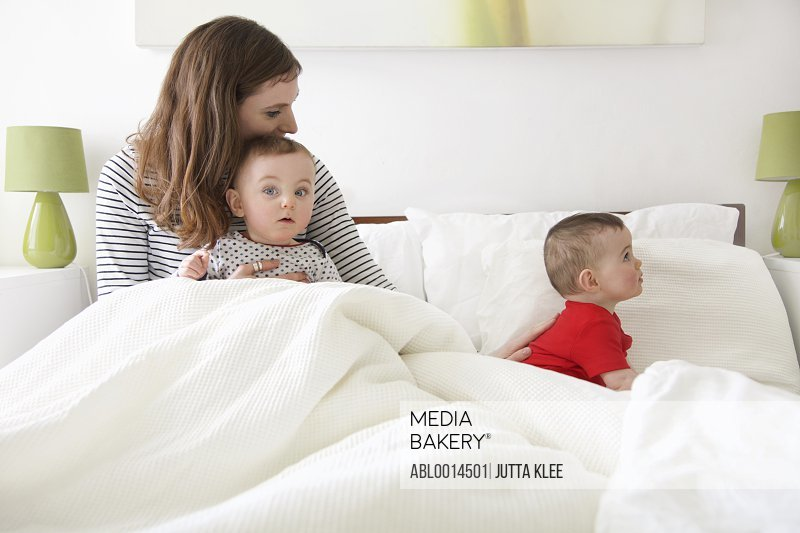 Mother in Bed with Baby Twins