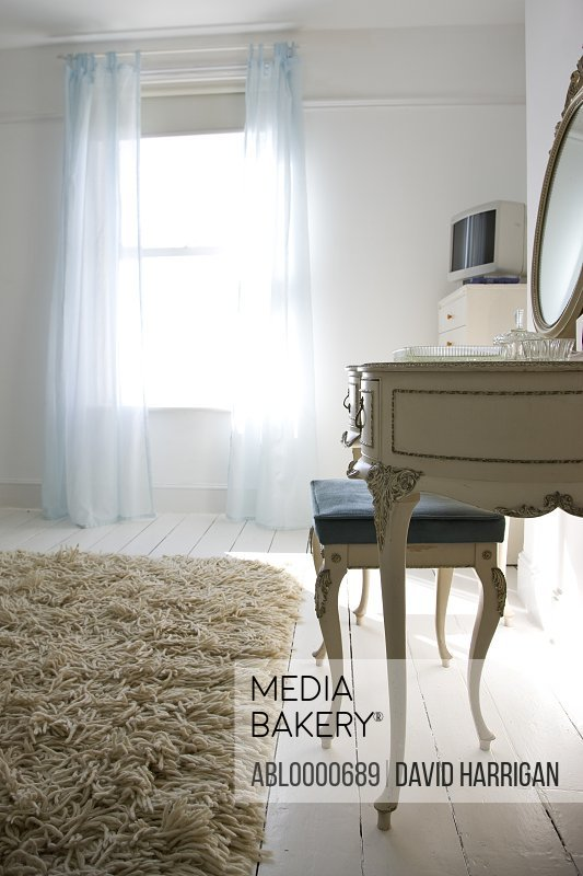 Bedroom  rug with dressing table and stool