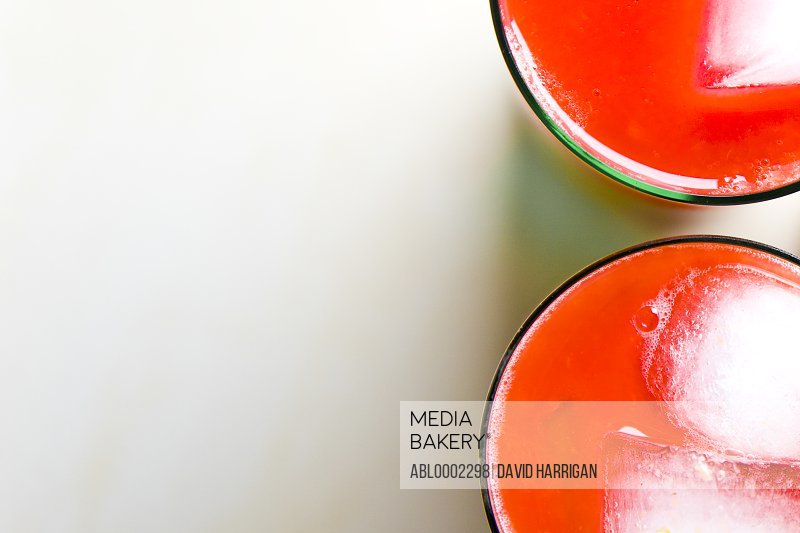 Two Glasses of Tomato Juice with Ice - High angle view