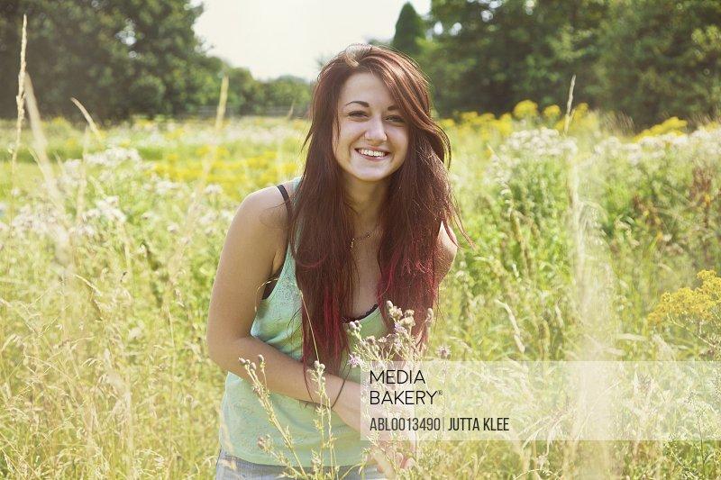 Smiling Teenage Girl in Meadow