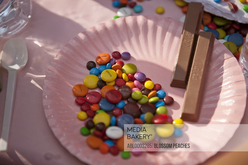 Pink Paper Plate with Multicoloured Candies and Chocolate Sticks