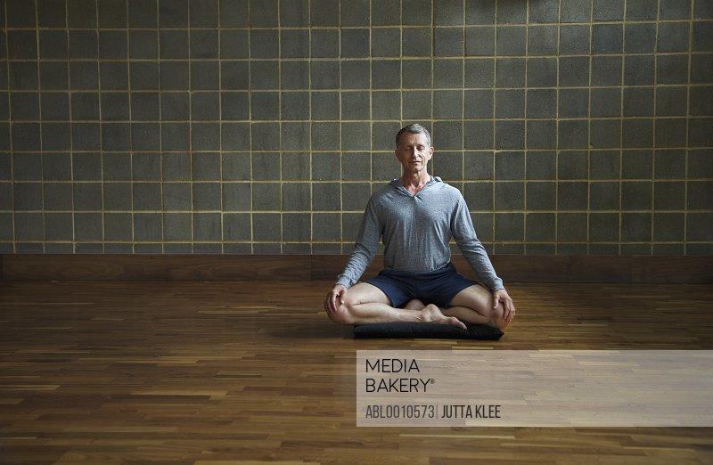 Mature Man Practicing Yoga, Easy pose
