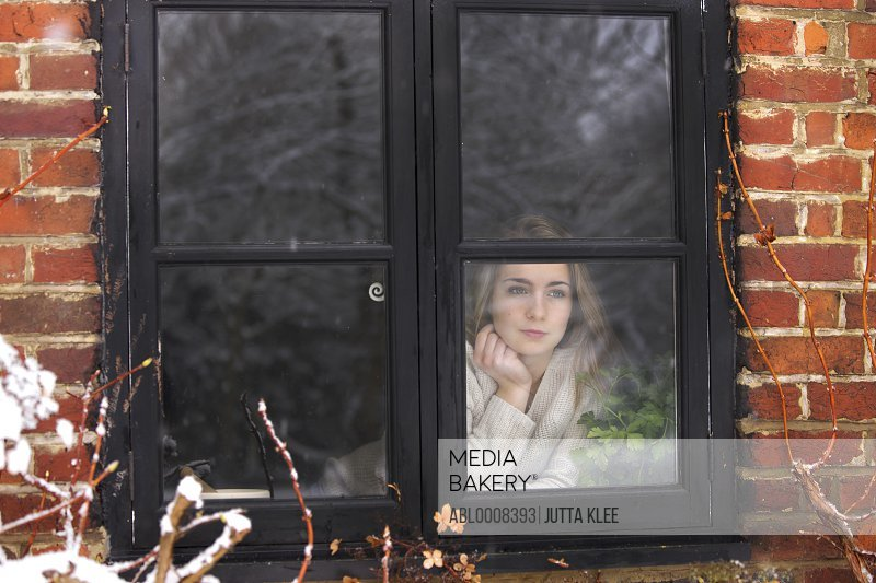 Teenage Girl Looking Out of Window