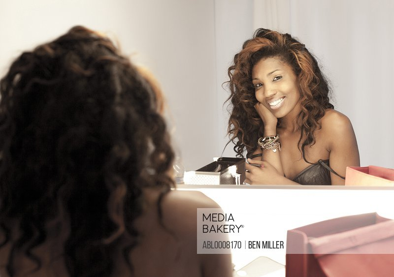 Smiling Woman In front of Dressing Room Mirror