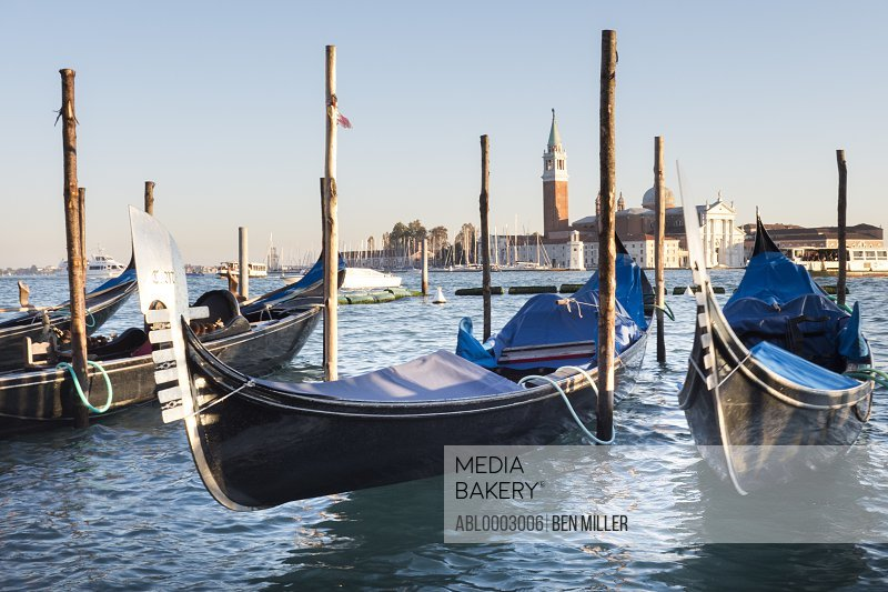 Gondolas and the Island and Church of San Giorgio Maggiore, Venice, Italy