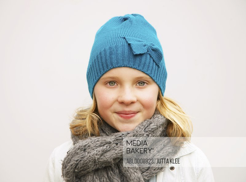 Portrait of Young Girl Wearing Wool Hat and Scarf
