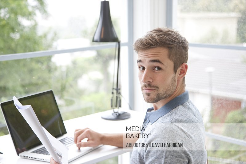 Man Sitting at Desk in Home Office