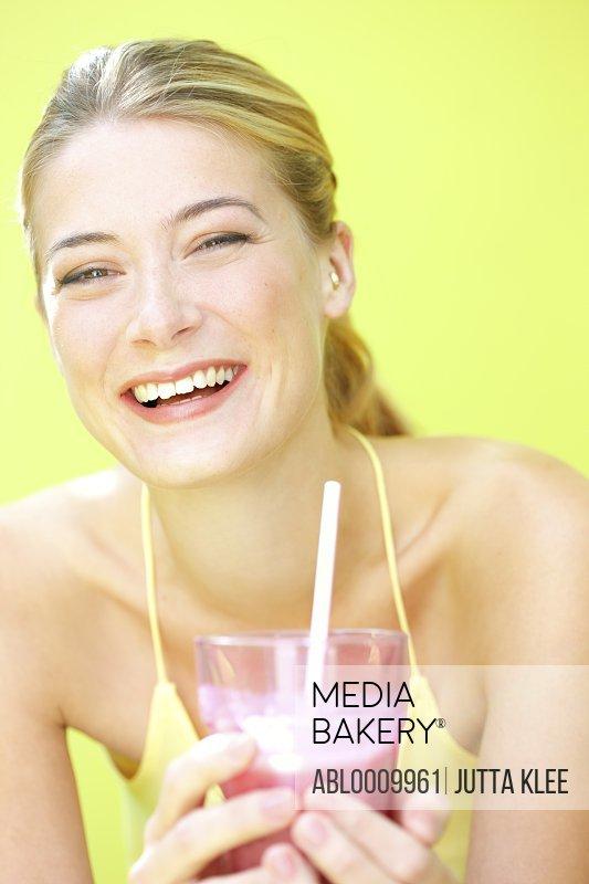 Woman Having Smoothie Smiling