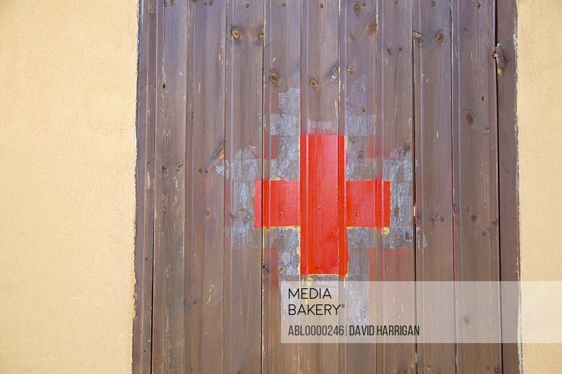 Close up of red cross on first aid room door