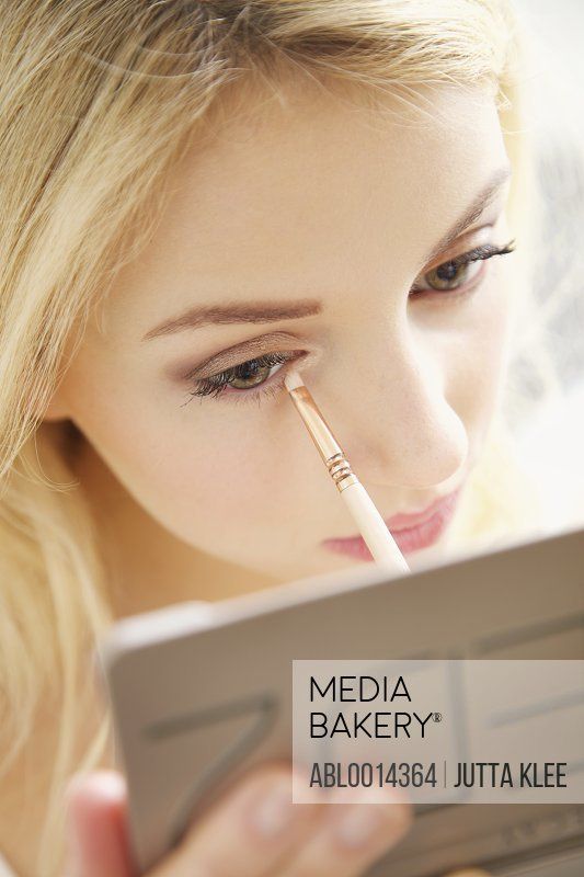Close up of Young Woman Applying Eye Shadow