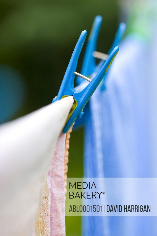 Close up of clothes pegs on a clothesline