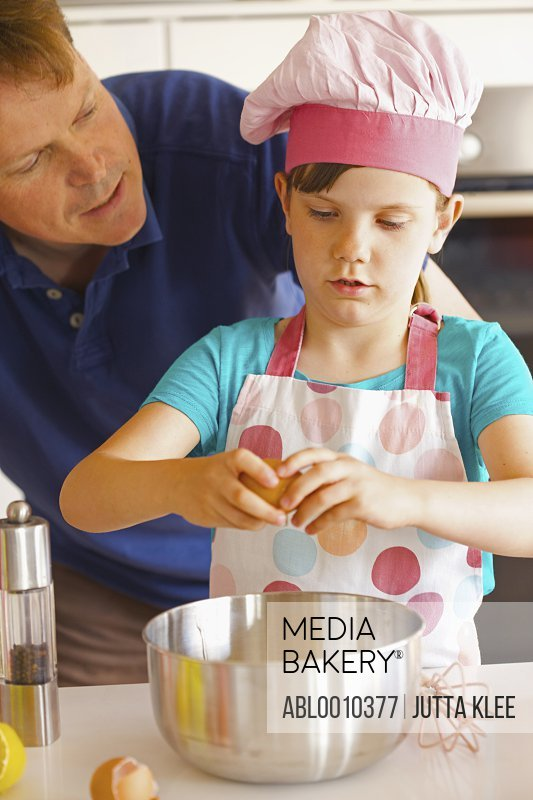 Father and Daughter Cooking in Kitchen