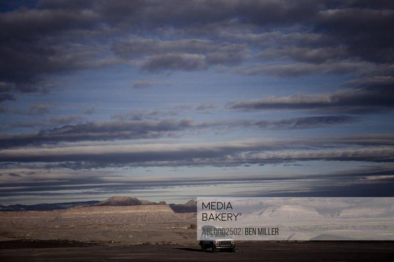 Car Parked on Remote Landscape