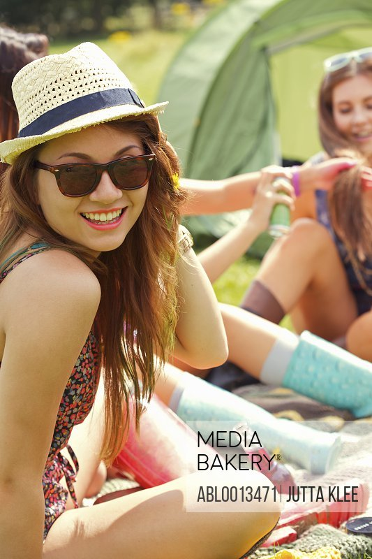 Smiling Teenage Girl with Straw Hat
