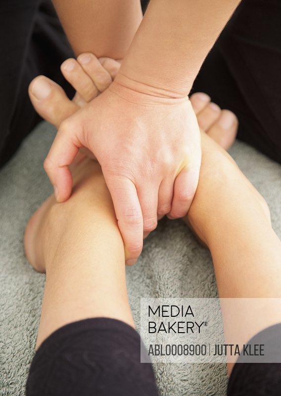 Woman Receiving Reflexology Treatment, Close-up View