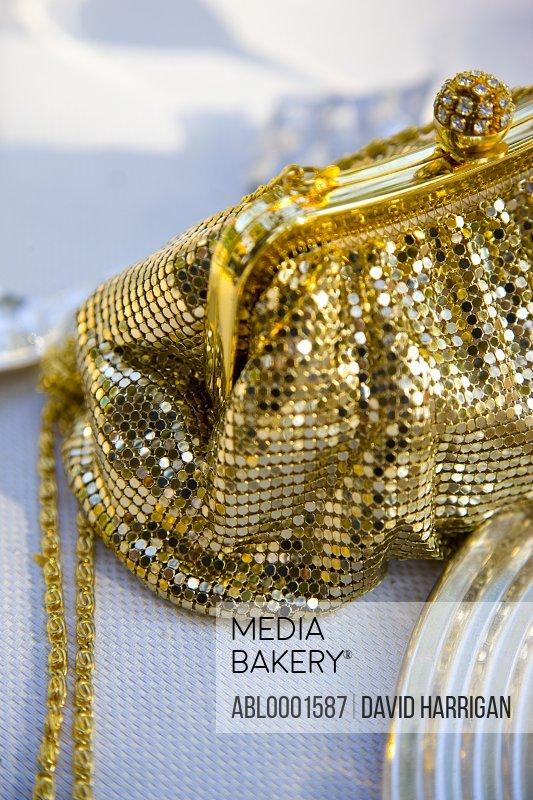 Gold chain mail handbag with rhinestone ball clasp