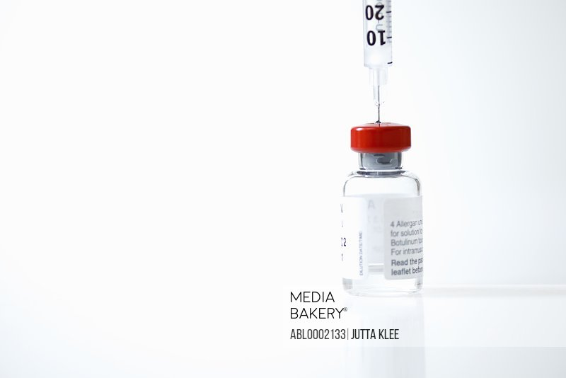 Hypodermic Needle Inserted in Medicine Vial
