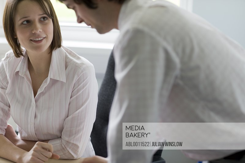 Portrait of businessman and businesswoman working and interacting