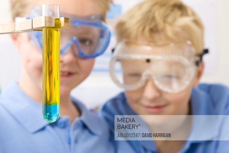 Two boys holding a test tube