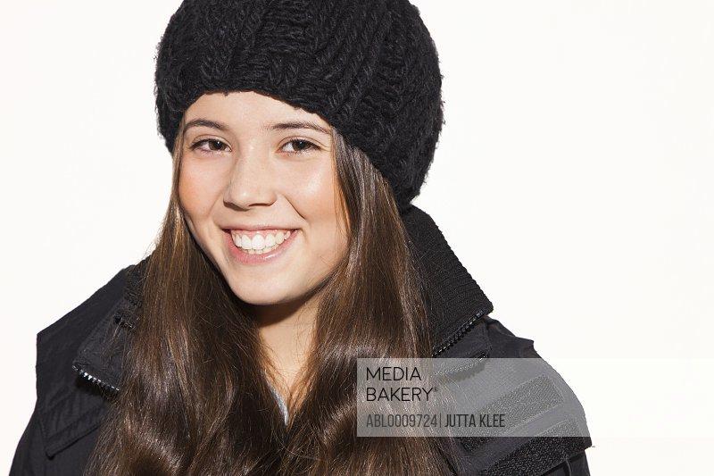 Teenage Girl Wearing Wool Hat Smiling