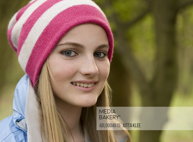 Close up of teenaged girl wearing woolly hat
