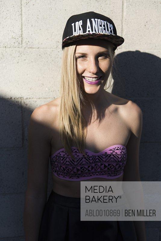 Smiling Young Woman Wearing Baseball Cap