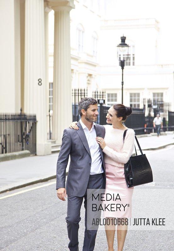 Couple Walking on City Street, London, England