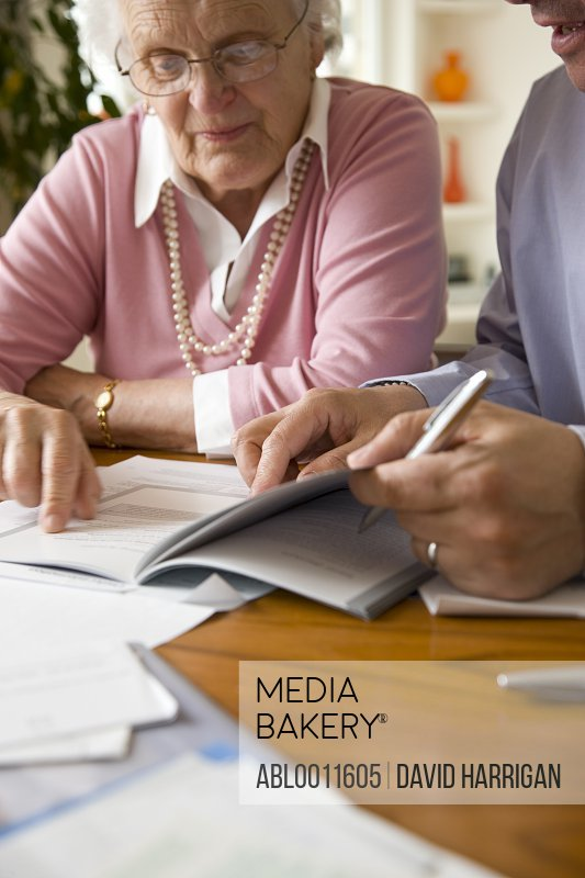 Portrait of a businessman and woman sitting and looking at documents