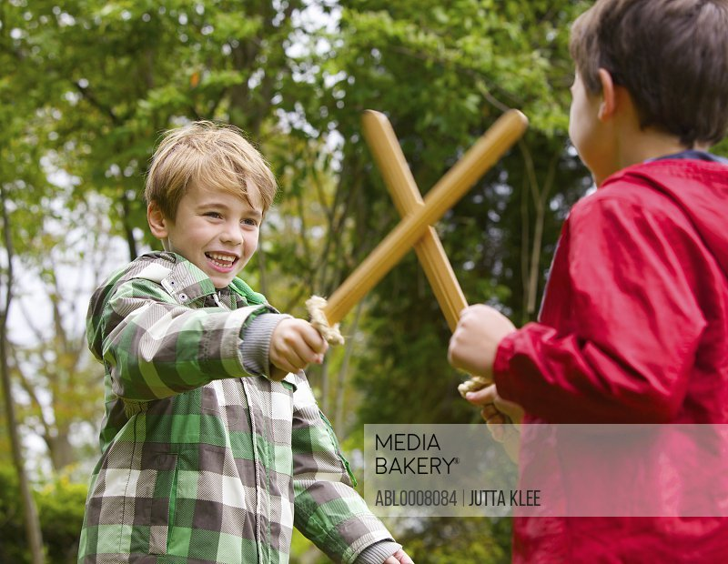 Two Boys Playing at Sword Fighting