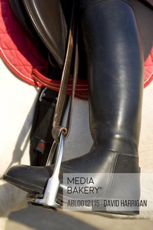 Close up of a riding boot on a stirrup