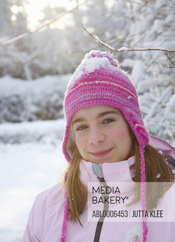 Girl Wearing Pink Woolly Hat in the Snow