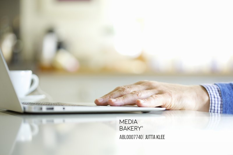 Close up of Man's Hand Using Laptop