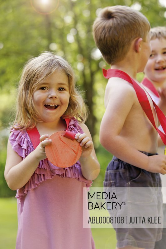 Smiling Young Girl with Cardboard Medal