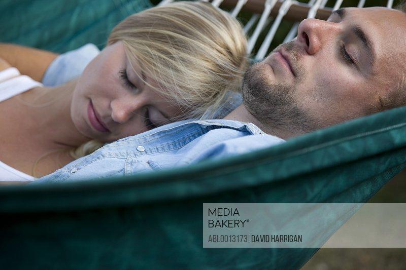 Close up of Couple Lying on Hammock