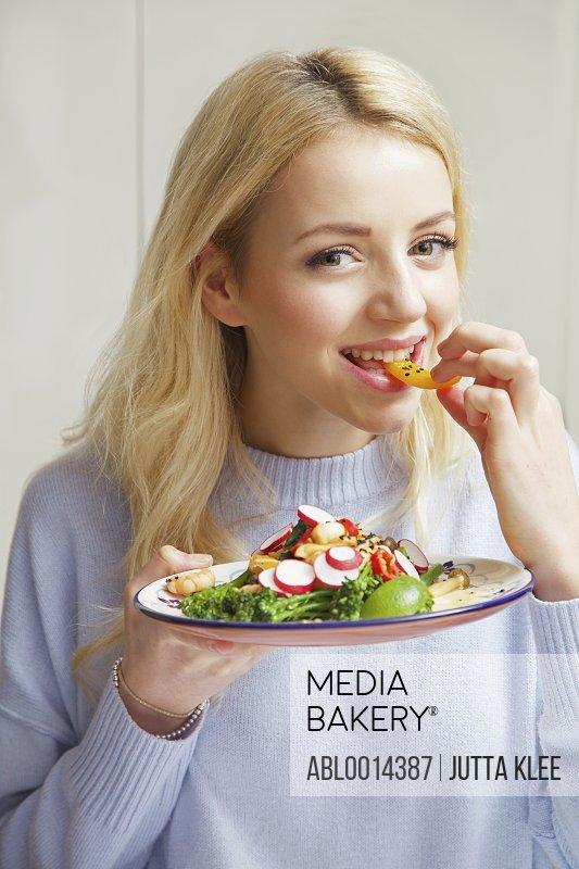 Woman Eating Stir Fry Vegetables