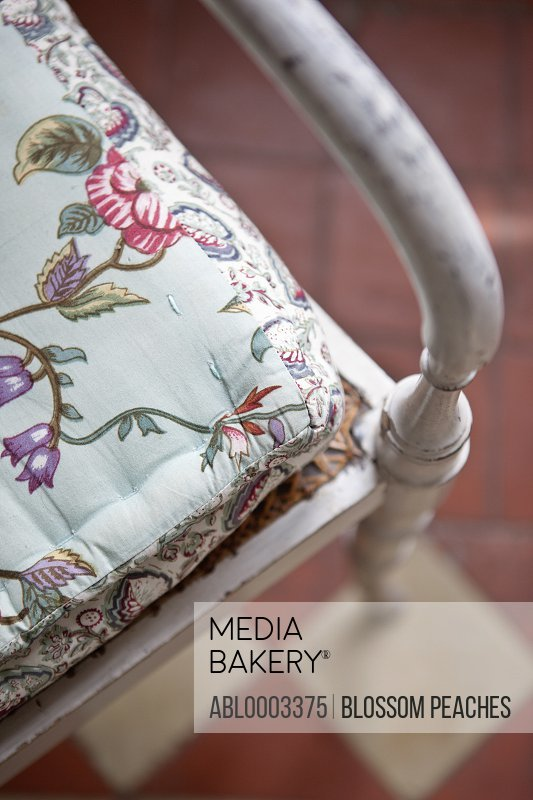 Cropped Elevated View of Wood Chair with Floral Pattern Cushion