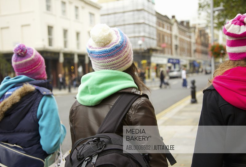 Back View of Teenage Girls Walking on a London Street