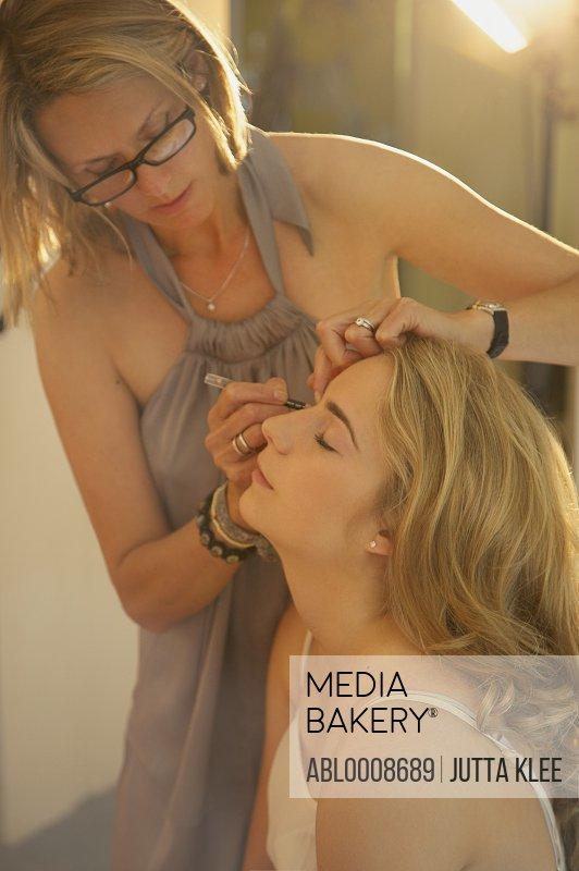 Make up Artist Applying Eyeliner on Teenage Girl
