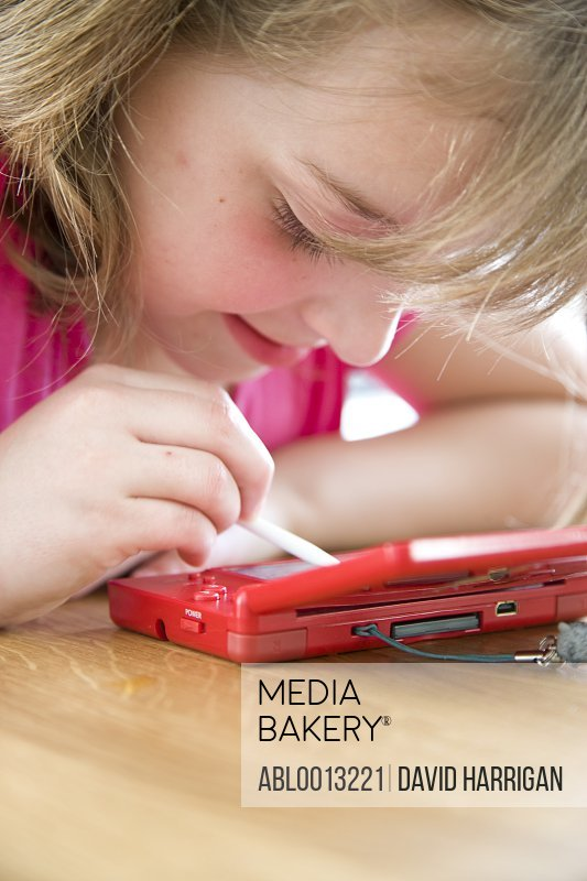 Girl Playing with Handheld Video Game