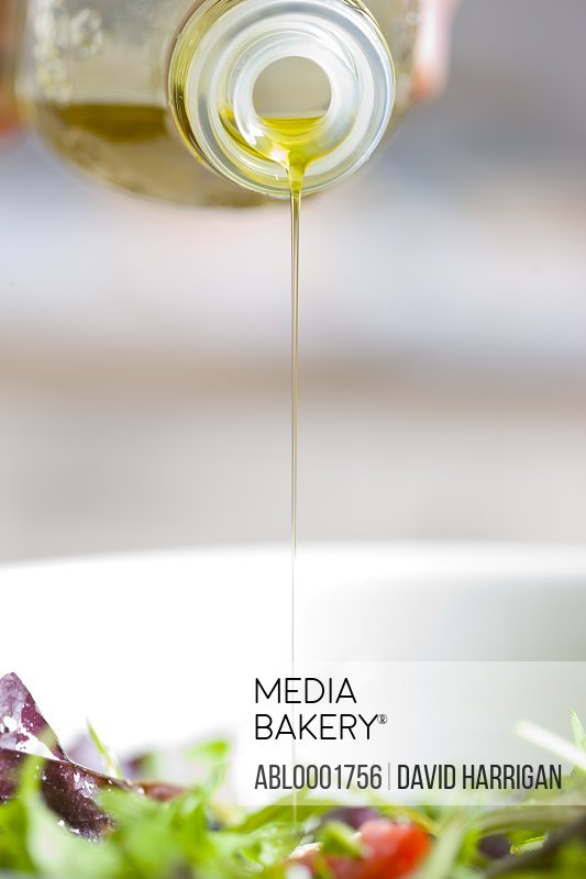 Olive oil drizzle over mixed salad